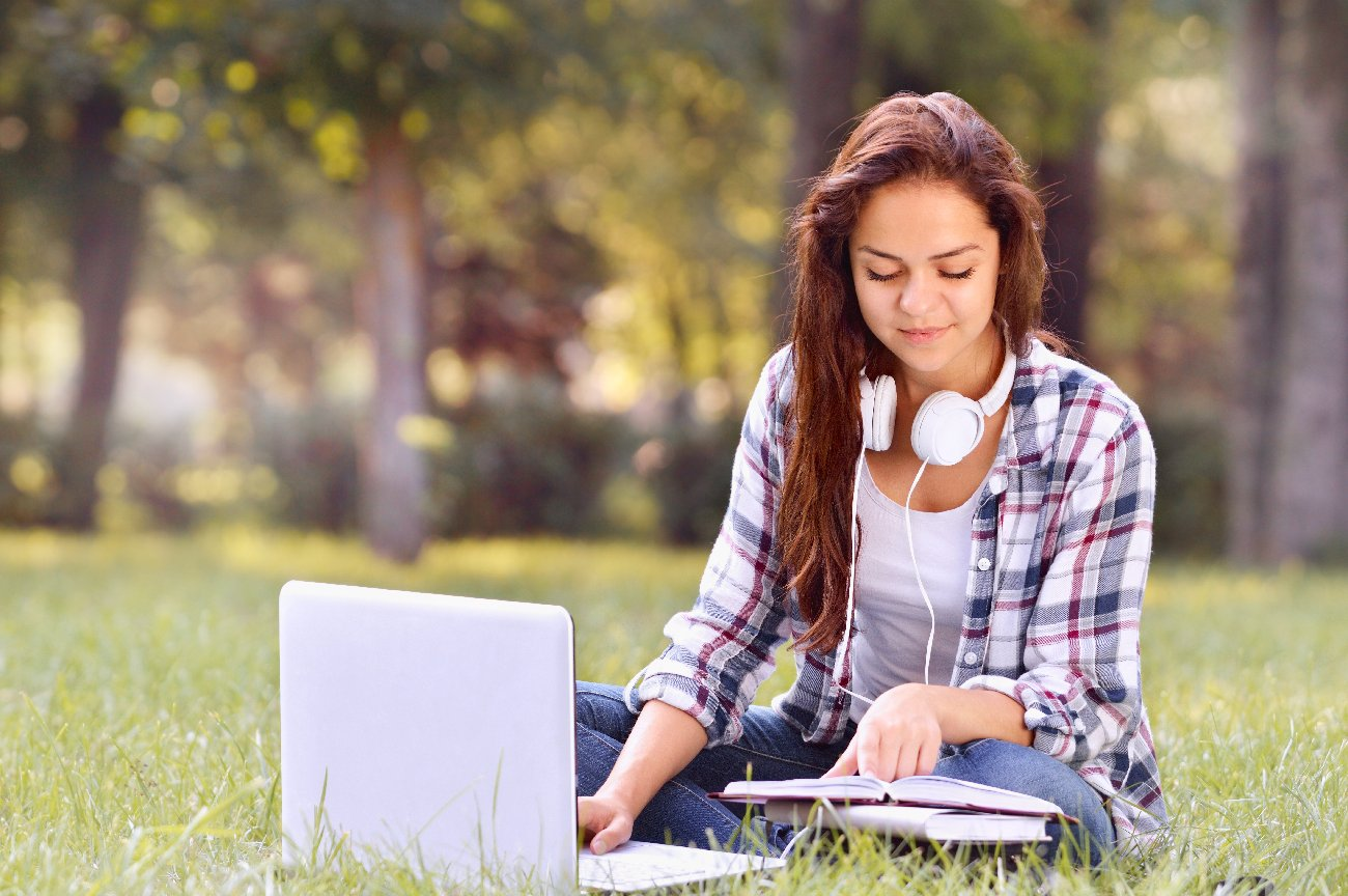 Picture of girl with a computer outdoors